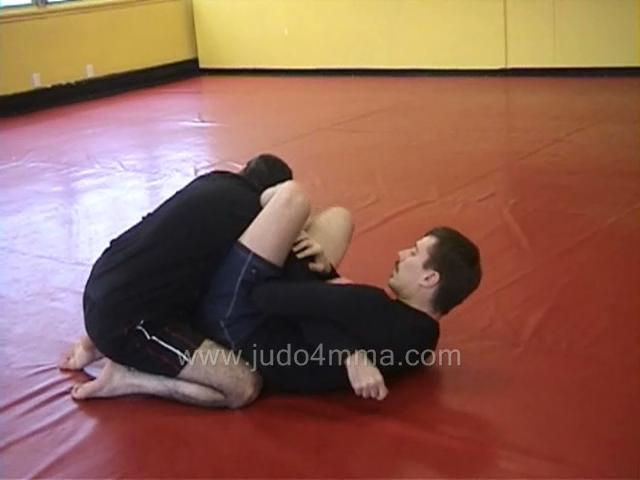 Click for a video showing judo and MMA techniques - Escapes, Sweeps, and Reversals - 8-9