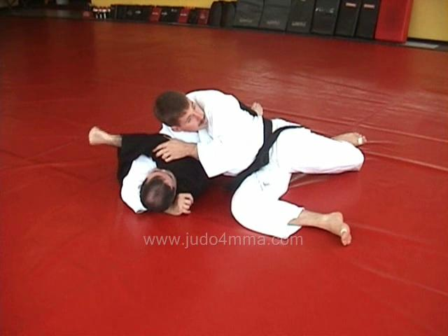 Click for a video showing how to transition from Kesa Gatame to Kata Gatame - Scarf Hold to Should Lock/Hold