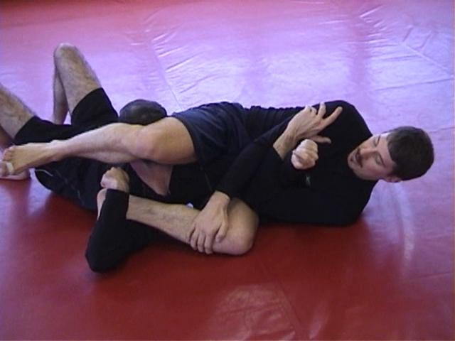 Click for a video showing a Judo for MMA technique called Kubi Hishigi from juji gatame - Neck Crush from the cross arm lock position