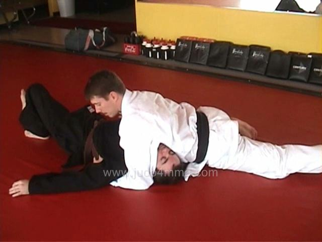 Click for a video showing how to do Kuzure Kami Shiho Gatame - Variation on Upper Four Quarters Hold
