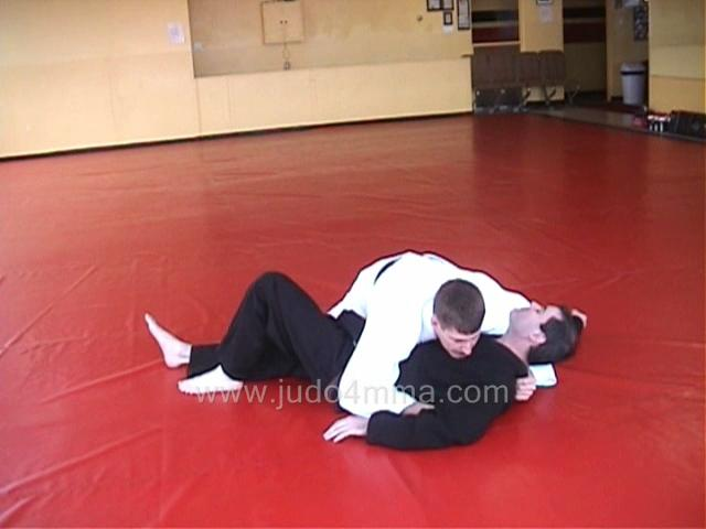 Click for a video showing how to do Kuzure Yoko Shiho Gatame - Variation on Side Four Quarters Hold