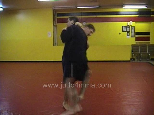 Click for a video showing a Judo for MMA technique called Okuri Ashi Harai - Assisted Ankle Sweep -  asssited ankle sweep